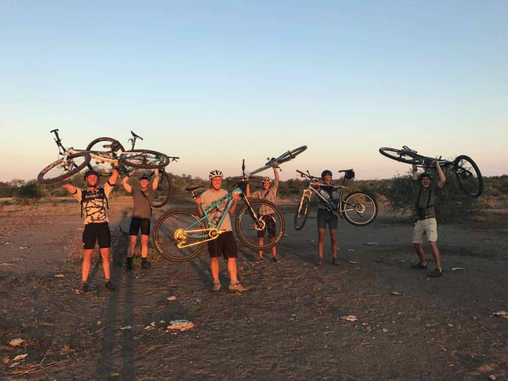Cyclists on Limpopo riverbed