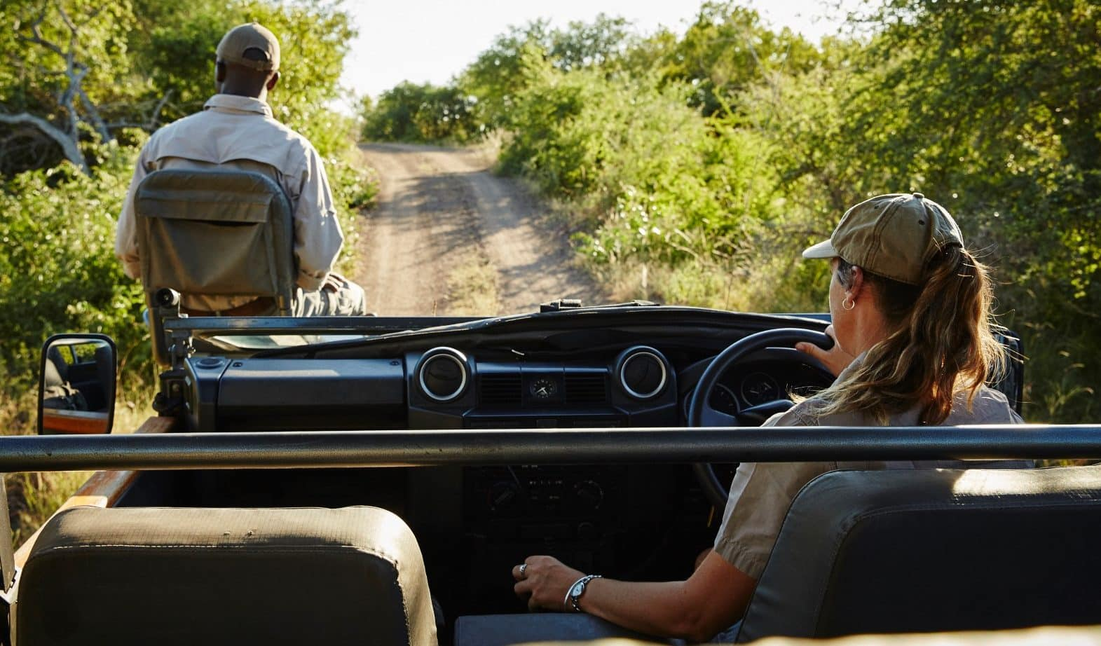 Guide and tracker on Singita open vehicle