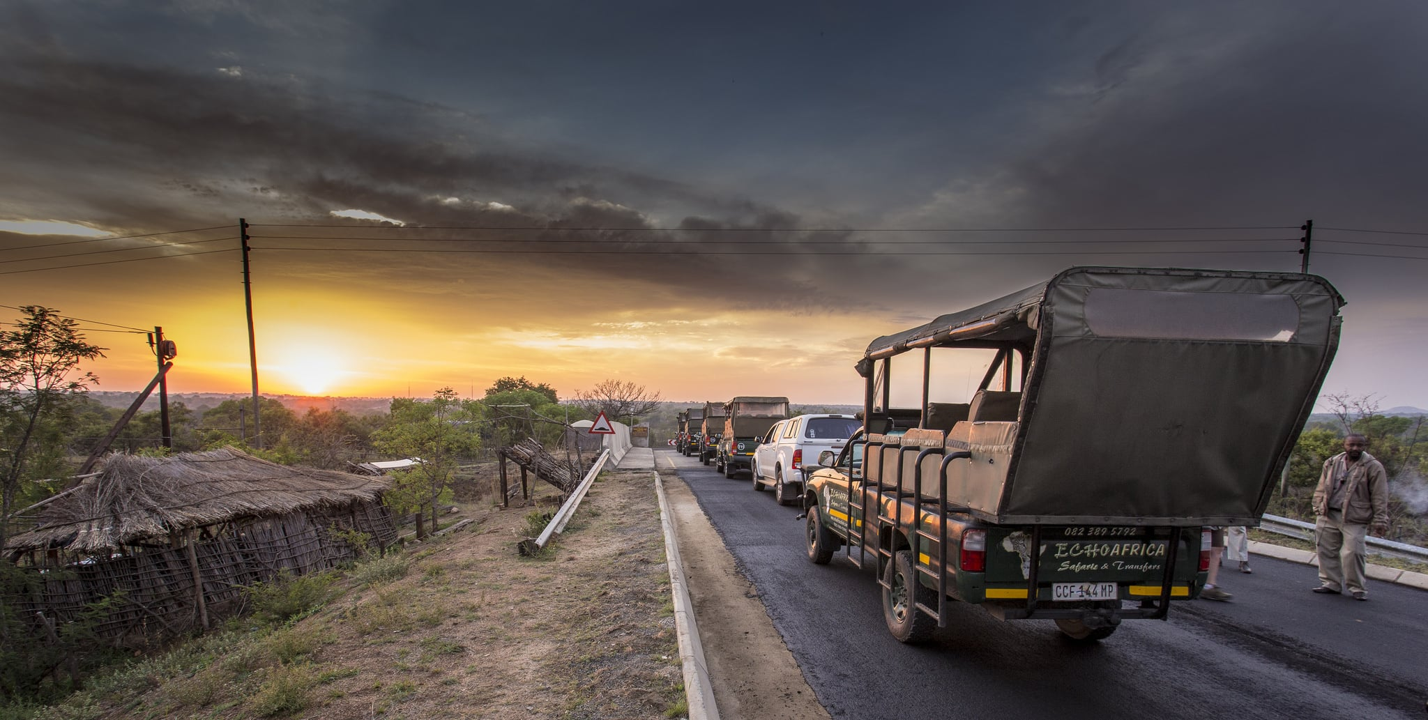 Queue of tour operator Open Safaris Vehicles at dawn, Phabeni gate, sheldrickfalls